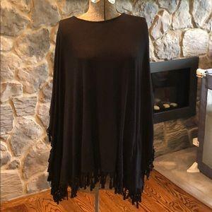 Black fringed poncho